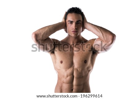 Muscular shirtless young man covering ears with hands, isolated on white