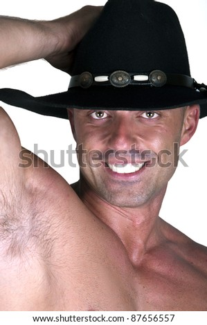 muscular smiling cowboy on white background - stock photo