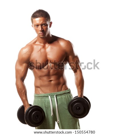 muscular super-high level  handsome man holding weights and posing on a white background - stock photo