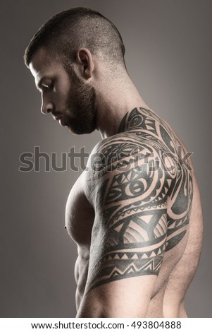 Muscular tattoo man from the back - black and white photo