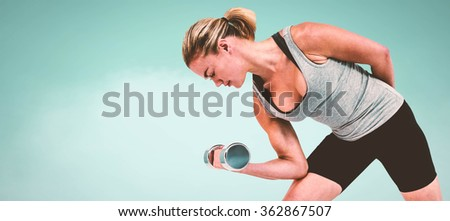 Muscular woman working out with dumbbells against blue background Muscular woman working out with dumbbells on white background