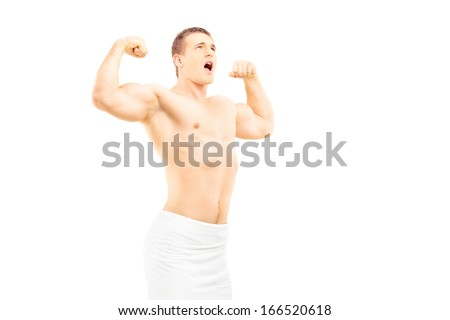 Muscular young man in towel posing, isolated on white background