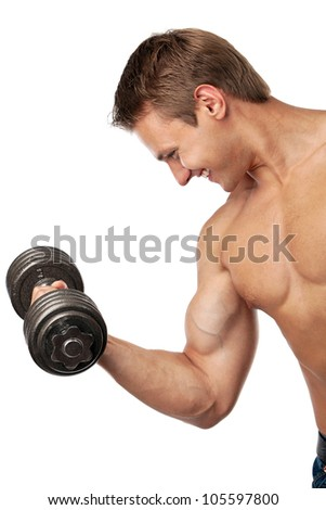Muscular young man lifting a dumbbell over white - stock photo