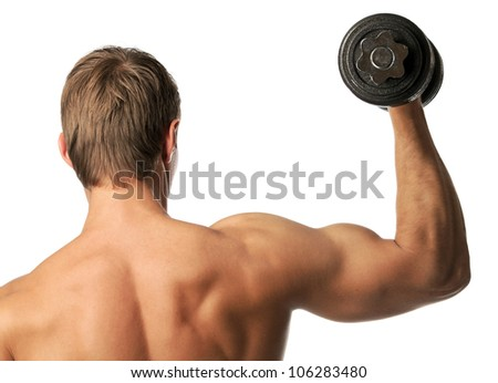 Muscular young man lifting a dumbbell over white, rear view - stock photo