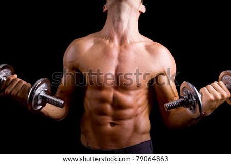 Muscular young man lifting dumbbells on black background. - stock photo