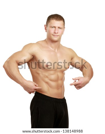 Muscular young man showing abs, isolated o white background - stock photo