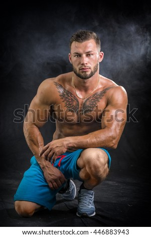 Muscular young man standing shirtless