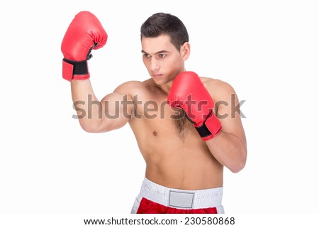 Muscular young man with boxing gloves in sports outfit on white background.
