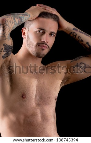 Muscular young man with many tattoos, dragan style - stock photo