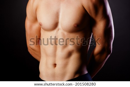 Muscular young sexy nude man on studio - stock photo