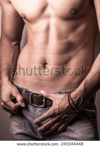 Muscular young sexy nude man on studio background  - stock photo