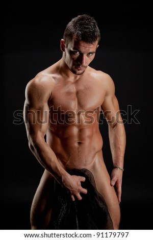 Muscular young sexy nude man wrapped in a silk cloth - stock photo