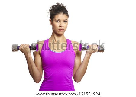 Muscular young woman exercising in sports outfit with dumbbells on white background