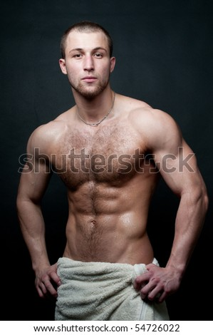 Musculed model posing in studio - stock photo