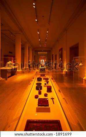 Museum-like setting with columns, spot lights & displays. More with keyword Series003