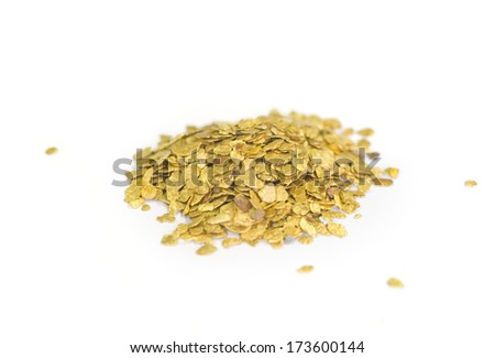 MUSEUM MINERAL SERIES: Pile of tiny, real gold nuggets. Isolated on white. - stock photo