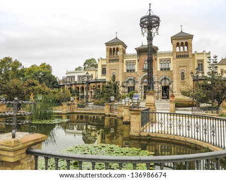 Museum of Arts and Traditions with pond in Maria Luisa Park, Seville - Spain. Built in art deco and mock mudejar style in the 1920's