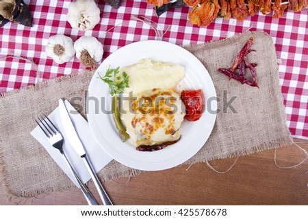 Mushroom and cheese kebab bake with potato paste - stock photo