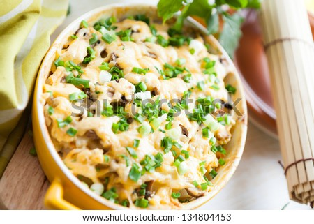 mushroom casserole with cheese and chives, closeup