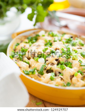 mushroom casserole with meat under Parmesan, close up