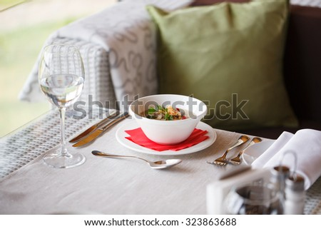 Mushroom cream soup on a table, food, berries - stock photo