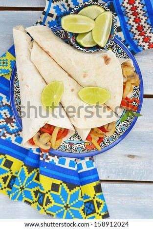 mushroom fajitas on a ornamental plate - stock photo