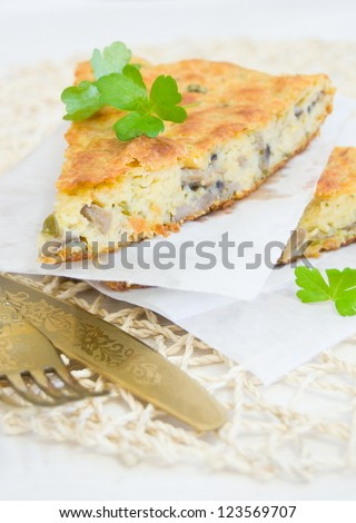 Mushroom pie slices, selective focus, closeup with fork and knife