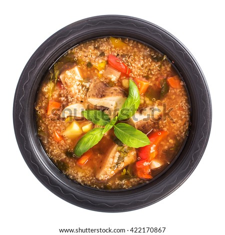 Mushroom quinoa soup isolated top view