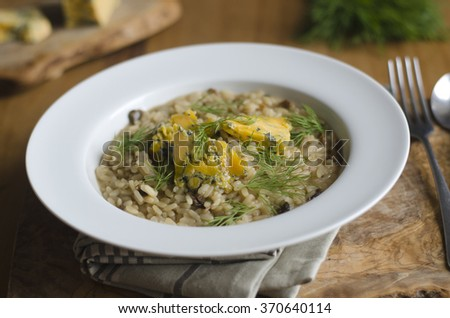 Mushroom risotto with melted blue cheese and dill - stock photo