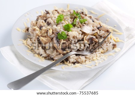 Mushroom risotto with parsley, italian cuisine.
