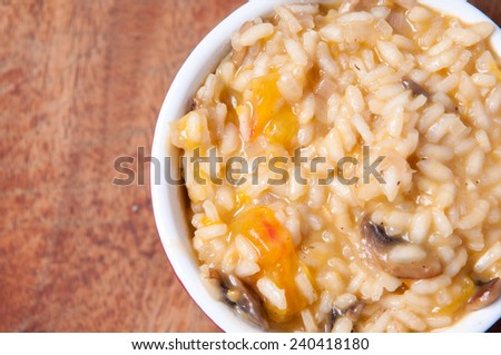 mushroom risotto with tomatoes - stock photo
