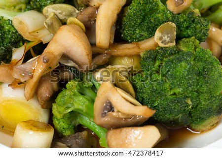 Mushroom salad with broccoli and pumpkin seeds. Macro. Photo can be used as a whole background.