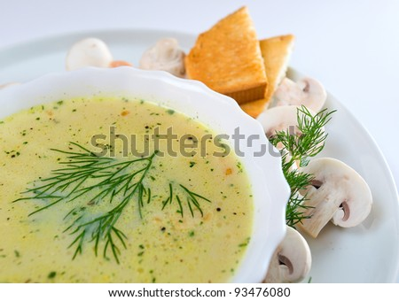 mushroom soup with dill, toasts and field mushrooms.