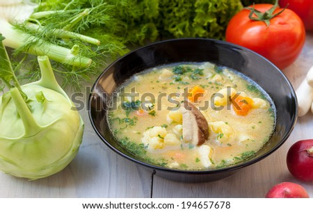 Mushroom soup with fresh vegetables - stock photo