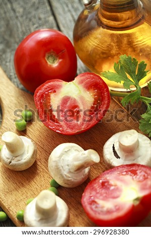 mushrooms and fresh vegetables prepared for cooking - stock photo
