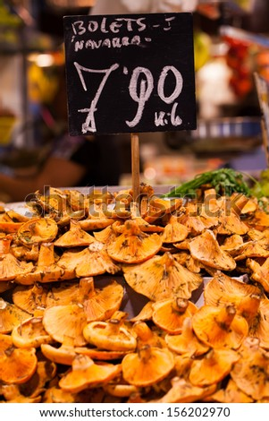 Mushrooms at a stand in the Boqueria Market, in Barcelona, Spain.  - stock photo