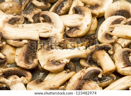 Mushrooms frying in pan