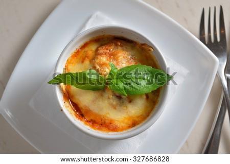 mushrooms gratin , white, orange brown cap boletus with cream, cheese, French dish julienne - stock photo