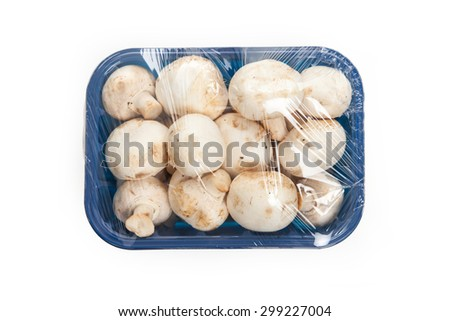 Mushrooms in blue plastic box isolated on white background