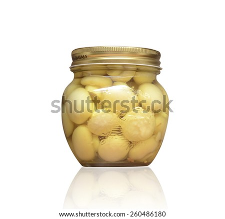 Mushrooms marinaded (champignons) in glass jar on a white background - stock photo