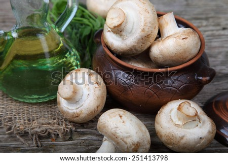 Mushrooms on old wooden background