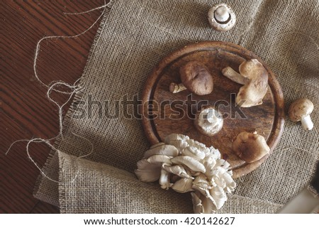 Mushrooms on wooden table top view