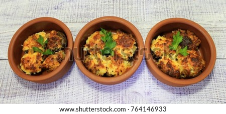 Mushrooms stuffed with vegetables baked in the oven with cheese