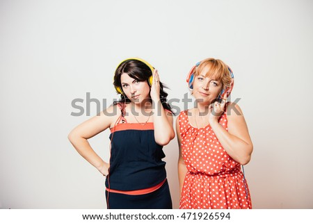 music and technology concept two girls
