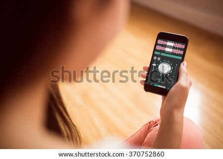 Music app against asian woman using phone with copy space - stock photo