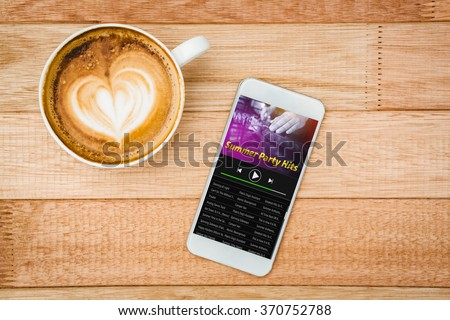 Music app against view of a heart composed of coffee - stock photo