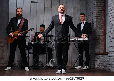Men in Suits, a septet of business execs, will join forces with the horn section of the Toronto Star's in-house band, Holy Joe and the Principles, when it headlines at the El Mocambo on Friday.