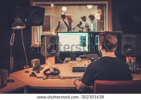 Music band during cd recording in studio  - stock photo