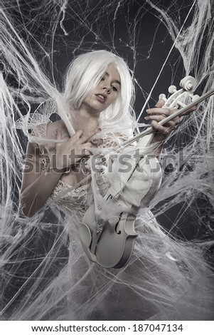 Music. Beautiful model with long white hair and vintage corset