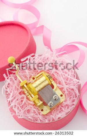 Music box in gift box - stock photo